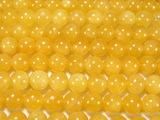 Нить бусин из кальцита желтого, шар гладкий 10мм